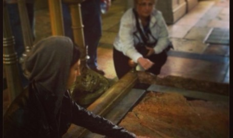 Me touching a piece of Jesus' tomb.
