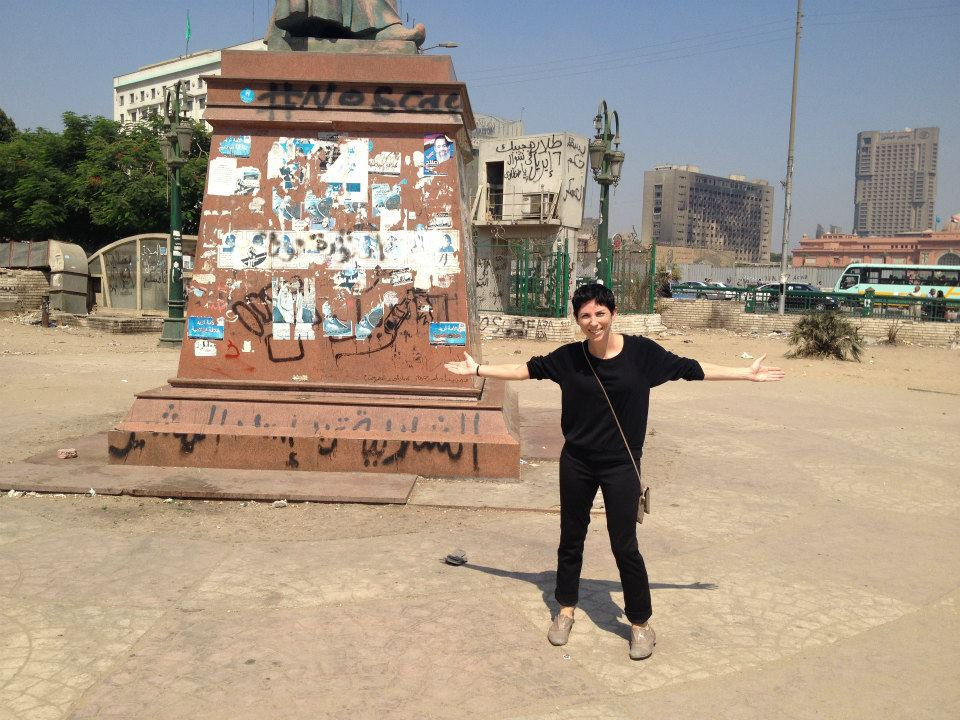 Yes, I asked a male stranger to take a photo of me posing alone in Tahrir Square.